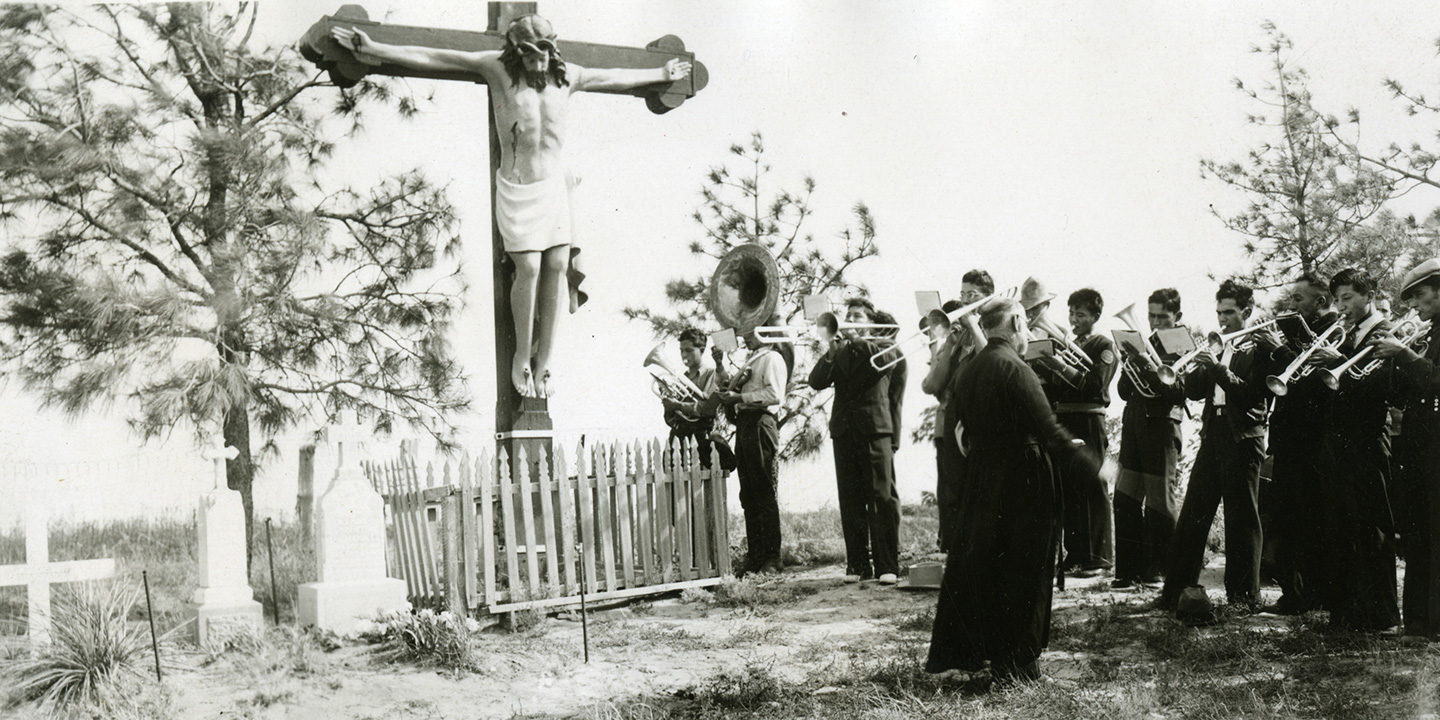 Marching band playing in cemetery, 1937, St. Francis, SD