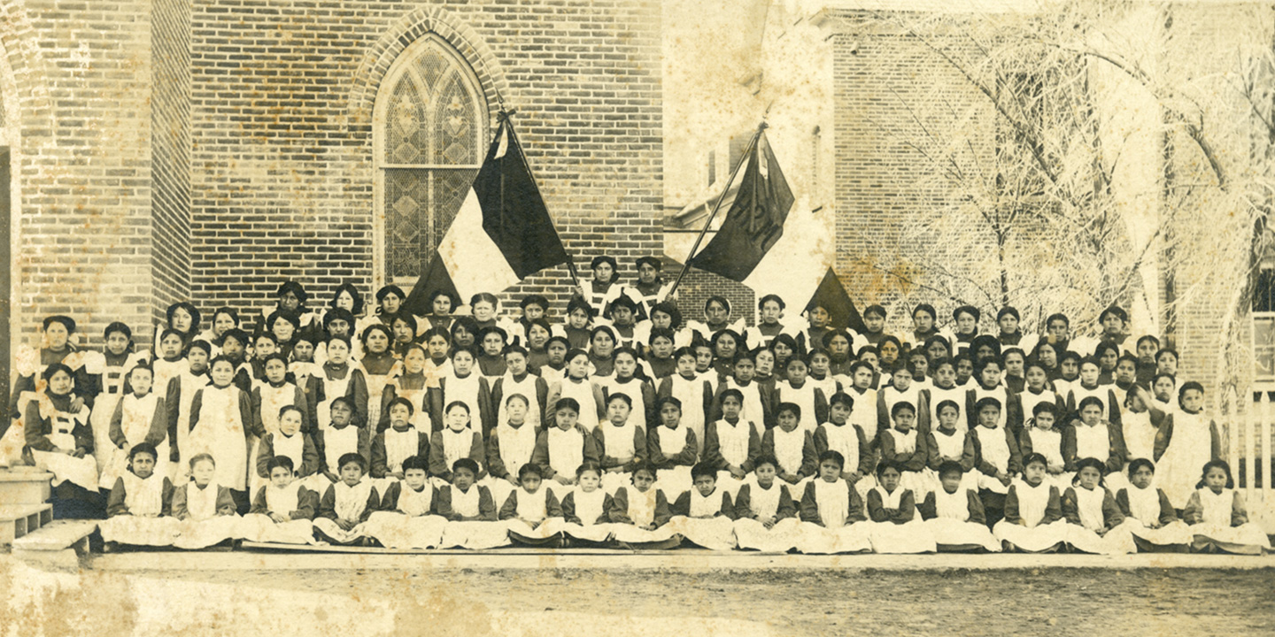 Elementary girls with banners in front of school, n.d., 1890-1920, Holy Rosary Mission, SD